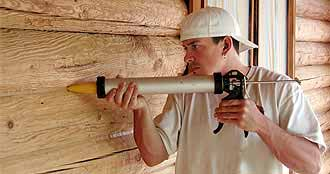 Caulking a log home with Energy Seal by Perma-Chink